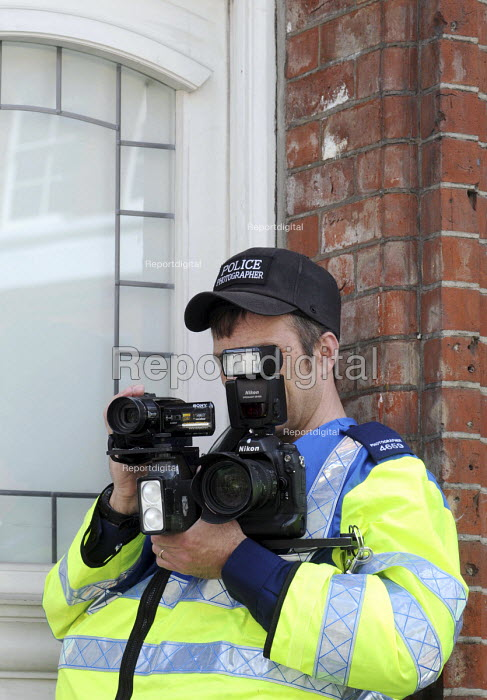 Police photographer recording the 2010 May Day rally London - Stefano Cagnoni - 2010-05-01