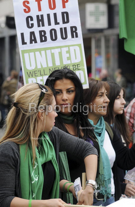Women with placards reading: Stop Child Labor on the 2010 May Day rally. London - Stefano Cagnoni - 2010-05-01
