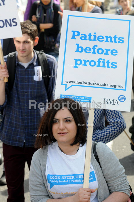 Young woman bearing a BMA banner reading Patients Before Profits on the national demonstration in support of the welfare state and continued state investment in public services and against any cuts in provision - Stefano Cagnoni - 2010-04-10