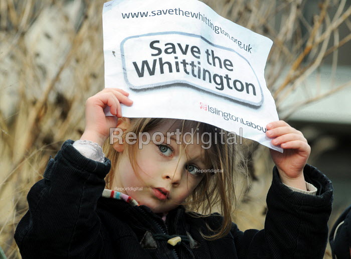 A young girl joins a rally outside the Whittington Hospital in north London in protest at the threatened closure of its A & E & Maternity Departments through cuts in funding - Stefano Cagnoni - 2010-02-27
