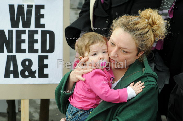 Mother with her baby at a rally outside the Whittington Hospital London in protest at the threatened closure of its A & E & Maternity Departments through cuts in funding - Stefano Cagnoni - 2010-02-27