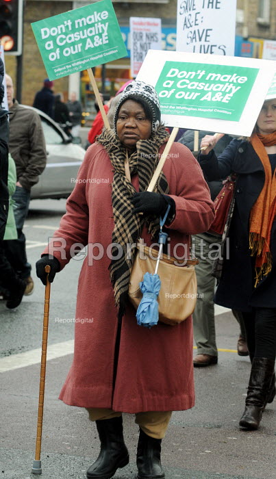 Older woman with a walking stick on the march to the Whittington Hospital London in protest at the threatened closure of its A & E & Maternity Departments through cuts in funding - Stefano Cagnoni - 2010-02-27