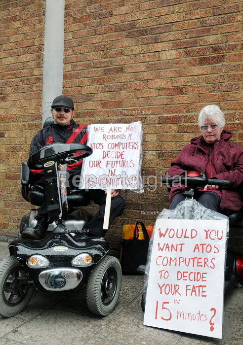 Day of action against welfare cuts protest against benefit cuts at the ATOS Assessment Centre, Jobcentre Plus, Islington. ATOS Healthcare have been awarded the contract to assess claimants for disability and incapacity benefit. This private company gets paid millions to carry out dubious medical assessments for Employment and Support Allowance (ESA), which is replacing Incapacity Benefit. - Stefano Cagnoni - 2011-04-17