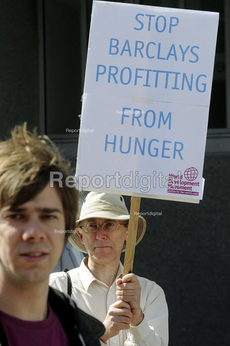 Protestors from the WDM lobby shareholders queueing to attend the 2011 Barclays Bank AGM over the bank's trading in global food prices to increase their overall profit, to the detriment of the poor who suffer from food price increases. - Stefano Cagnoni - 2011-04-27