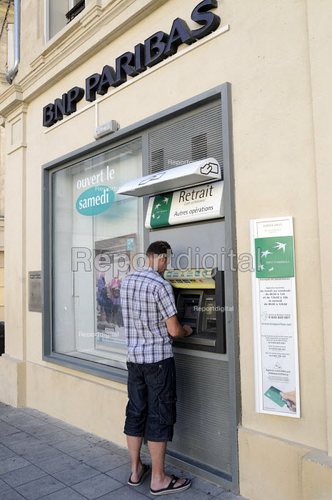 ATM being used at a BNP bank in southern France the BNP is the largest bank in the eurozone. - Stefano Cagnoni - 2011-08-10