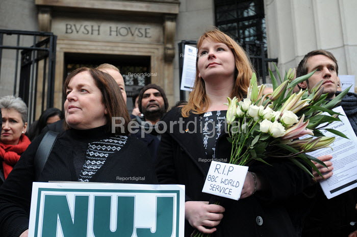 NUJ protest outside Bush House against BBC plans to cut hundreds of jobs in BBC World Service as a result of government funding cuts. Deputy General Secretary of the NUJ, Michelle Stanistreet, holds lilies bearing the inscription RIP BBC World Service. - Stefano Cagnoni - 2011-01-26