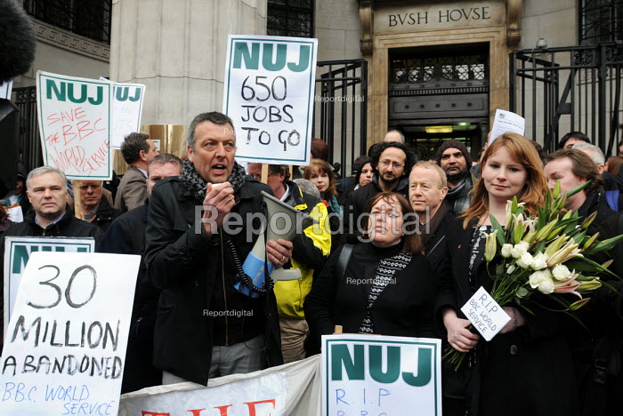 Jeremy Dear, General Secretary of the NUJ, addresses BBC staff and supporters as they protest outside Bush House against BBC plans to cut hundreds of jobs in BBC World Service as a result of government funding cuts. Deputy General Secretary of the NUJ, Michelle Stanistreet, holds lilies bearing the inscription RIP BBC World Service. - Stefano Cagnoni - 2011-01-26
