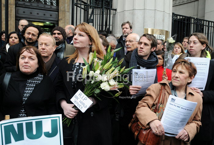 BBC staff and supporters protest outside Bush House against BBC plans to cut hundreds of jobs in BBC World Service as a result of government funding cuts. Deputy General Secretary of the NUJ, Michelle Stanistreet, holds lilies bearing the inscription RIP BBC World Service. - Stefano Cagnoni - 2011-01-26