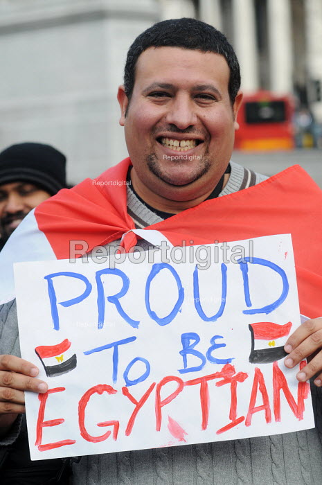 Global Day for Egypt organised by the TUC and Amnesty International. People celebrate the resignation of Mubarak. Trafalgar Square, London. Supporter bears placard reading: Proud to be Egyptian. - Stefano Cagnoni - 2011-02-12