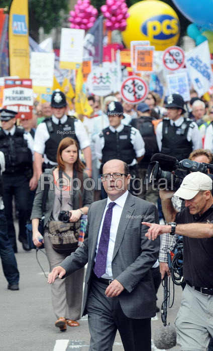 BBC News Political Editor Nick Robinson at work with a BBC cameraman covering the demonstration through London by joint trade unions in support of a national one day strike by union members in education and the civil service for fair pensions - Stefano Cagnoni - 2011-06-30