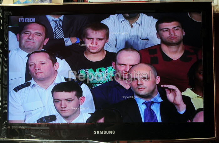 BBC Question Time programme, broadcast for the very first time from inside Wormwood Scrubs Prison. An inmate (with arm raised) and with prison guards to his right asks a question about voting rights for prisoners. - Stefano Cagnoni - 2011-05-19