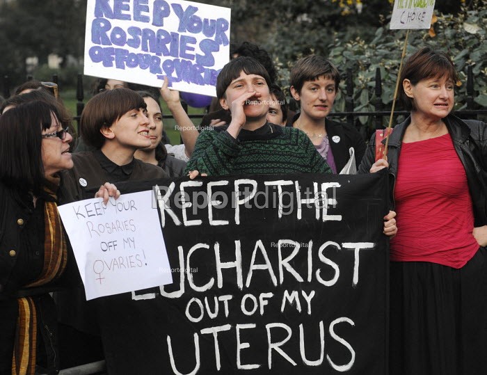 'Keep The Eucharist Out Of My Uterus' reads a banner held by Pro-abortion campaigners in support of a woman's right to choose as they stage a counter demonstration to the '40 Days For Life' anti-abortion campaigners vigil of prayer outside the offices of the British Pregnancy Advisory Council in Bedford Square. - Stefano Cagnoni - 2012-03-30