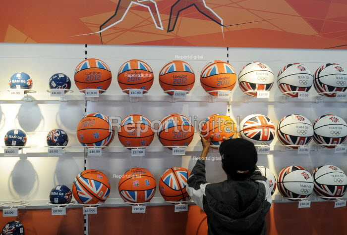 Teenange boy looking at basketballs in the London2012 Megastore inside the Olympic Park in Stratford, on the first competitve day of the London2012 Olympic Games. - Stefano Cagnoni - 2012-07-26