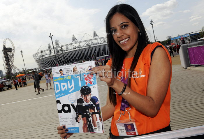 Official Programme seller inside the Olympic Park in Stratford on the first competitve day of the London2012 Olympic Games, with The Orbit and the Olympic Stadium behind her. - Stefano Cagnoni - 2012-07-28
