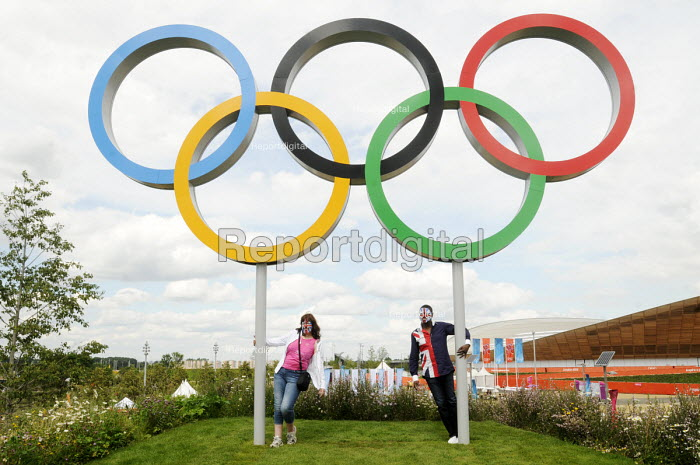 Friends from Yorkshire pose for photographs beside the Olympic Rings at the Olympic Park in Stratford on the first competitve day of the London2012 Olympic Games. - Stefano Cagnoni - 2012-07-28