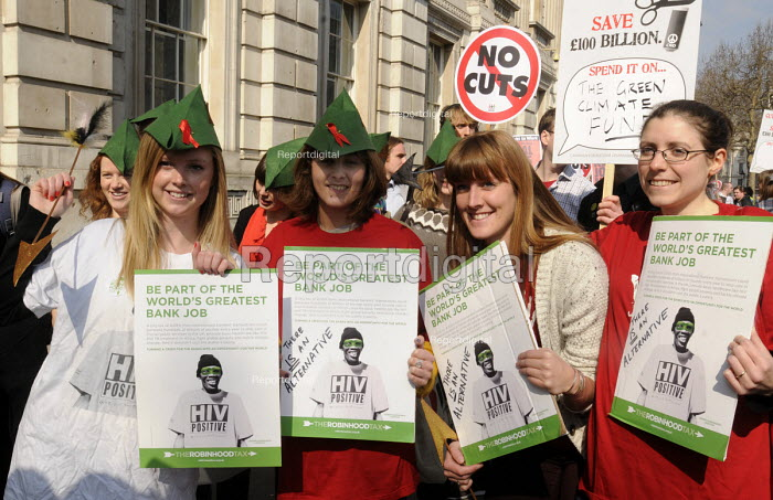 Protestors campaignig for the Robin Hood Tax demonstrate outside the gates at Downing Street in Whitehall as the Budget Day photocall was taking place with the Chancellor of the Exchequer on the steps of No 10. - Stefano Cagnoni - 2012-03-21