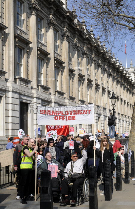 """Protest outside the gates at Downing Street in Whitehall re-enacting the """"Labour Isn't Working"""" dole queue as the Budget Day photocall was taking place with the Chancellor of the Exchequer on the steps of No 10. - Stefano Cagnoni - 2012-03-21"""