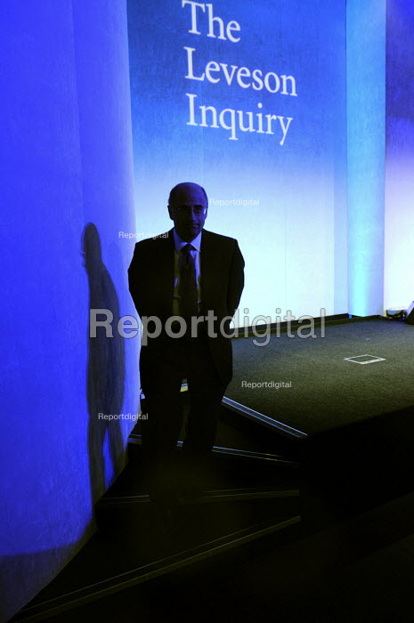 Lord Justice Leveson in shadow as he leaves his press conference at the QEII Centre having officially launched the results of his Inquiry into media ethics and practise: The Leveson Report. - Stefano Cagnoni - 2012-11-29