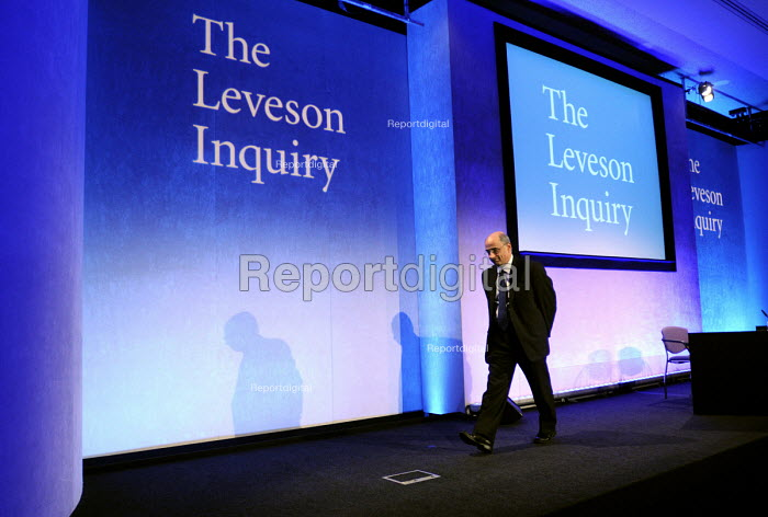 Lord Justice Leveson leaves his press conference at the QEII Centre having officially launched the results of his Inquiry into media ethics and practise: The Leveson Report. - Stefano Cagnoni - 2012-11-29