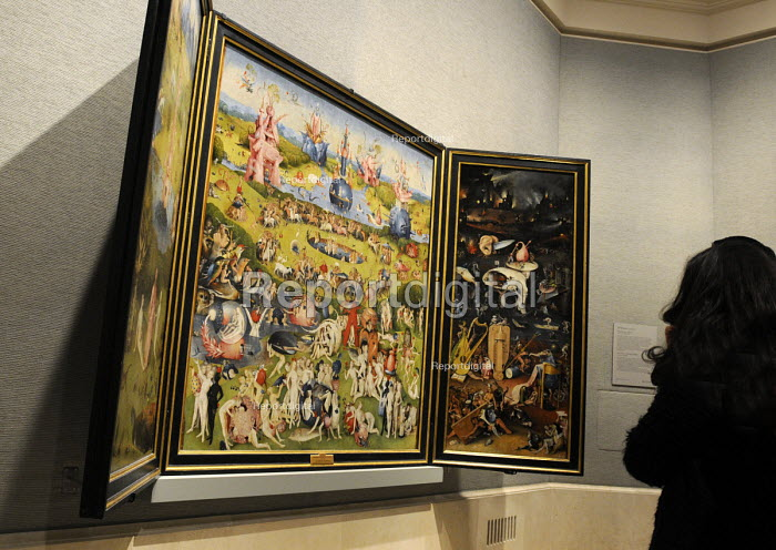 Visitors admire the triptych The Garden of Earthly Delights by Hieronymus Bosch at the Prado Museum of Art in Madrid, Spain. - Stefano Cagnoni - 2013-02-18
