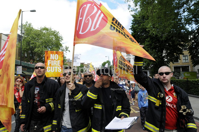 Firefighters at the front of a demonstration by local residents, supporters and trade union members against the planned closure of Clerkenwell Fire Station as part of austerity cuts to public services. - Stefano Cagnoni - 2013-06-08