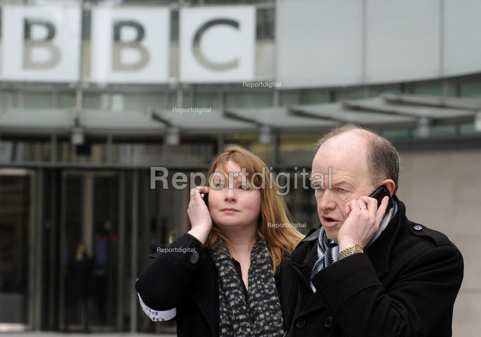 BBC Strike. NUJ & BECTU 12 hour official strike over cuts in staff, compulsory redundancies and management bullying. Michelle Stanistreet, Gen. Sec. of the NUJ & Gerry Morrissey, Gen. Sec. of BECTU talking on their mobile telephones outside New Broadcasting House, London - Stefano Cagnoni - 2013-03-28
