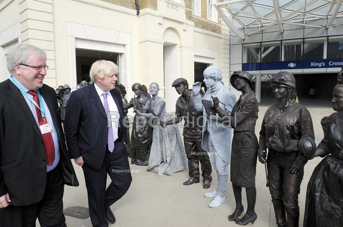Transport Minister, Patrick McLoughlin & Mayor of London, Boris Johnson are greeted by Victorian themed living statues at the official opening of the newly redeveloped King's Cross Square in front of King's Cross Station. - Stefano Cagnoni - 2013-09-26