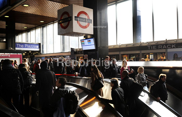 Commuters at Euston Station using the escalator to and from the Underground Station during the early morning rush hour. - Stefano Cagnoni - 2013-03-27