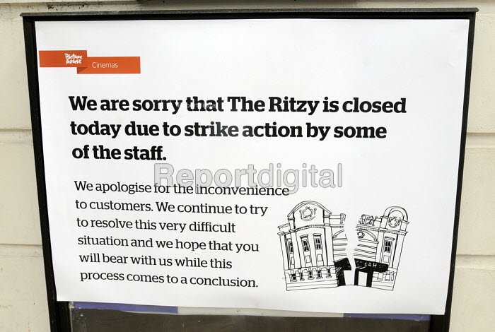 Sign outside the Ritzy Cinema in Brixton as staff there stage a 24 hour strike in support of their claim to be paid the London Living Wage. On zero hour contracts, they are currently paid less than the living wage hourly rate said to be necessary to be able to afford to live in London. - Stefano Cagnoni - 2014-04-11