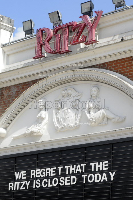 Sign put up by management at the Ritzy Cinema in Brixton as staff there stage a 24 hour strike in support of their claim to be paid the London Living Wage. On zero hour contracts, they are currently paid less than the living wage hourly rate said to be necessary to be able to afford to live in London. - Stefano Cagnoni - 2014-04-11
