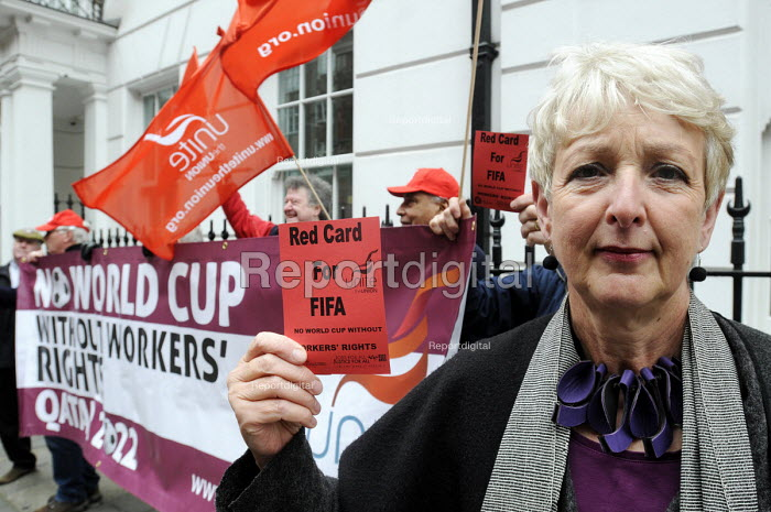 Gail Cartmel of UNITE holds Red Card at the Qatari embassy in London as part of Workers Memorial Day protest against loss of lives in the construction industry building the stadiums for the 2022 Football World Cup to be held in Qatar. - Stefano Cagnoni - 2014-04-28