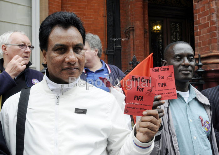 Campaigners hold Red Cards at the Qatari embassy in London as part of Workers Memorial Day protest against loss of lives in the construction industry building the stadiums for the 2022 Football World Cup to be held in Qatar. - Stefano Cagnoni - 2014-04-28