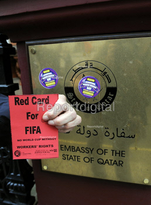 Red Card at the Qatari embassy in London, part of Workers Memorial Day protest against loss of lives in the construction industry building the stadiums for the 2022 Football World Cup to be held in Qatar. - Stefano Cagnoni - 2014-04-28