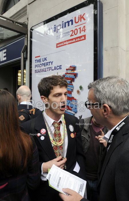 Local community activists talking to attendees at the MIPIM property fair held at Olympia in protest at lack of affordable housing in the UK. - Stefano Cagnoni - 2014-10-15