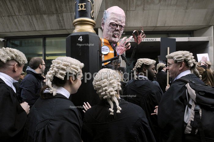 Save Legal Aid : wigged barristers towered over by a Chris Grayling puppet outside a blockaded Ministry of Justice, following their march their from Parliament. Grayling Day. Westminster. London. - Stefano Cagnoni - 2014-03-07