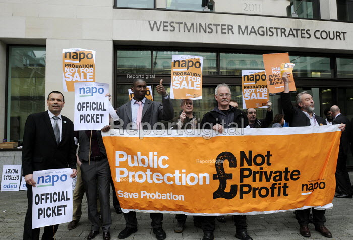 Front left Ian Lawrence, Gen. Sec. of NAPO, joins his members on the picket line at Westminster Magistrates Court as they stage their second national strike against privatisation of the probation service, part of a joint action with solicitors who also walked out in protest at cuts to legal aid. - Stefano Cagnoni - 2014-03-31