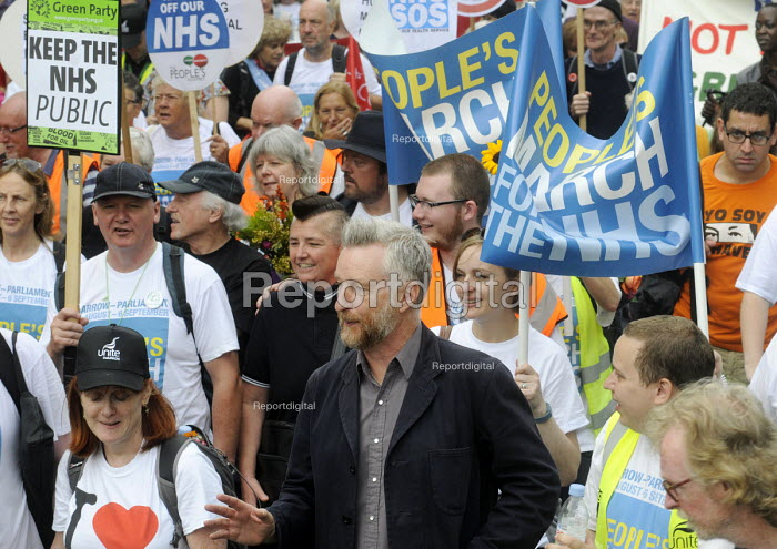 Jarrow People's March for the NHS. After 300 miles the march arrives in London for a demonstration and rally in support of the National Health Service. Singer Billy Bragg joins the march in support. - Stefano Cagnoni - 2014-09-06