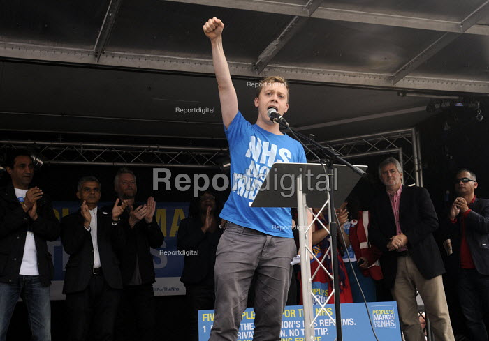 Jarrow People's March for the NHS. After 300 miles the march arrives in London for a demonstration and rally in Trafalgar Square in support of the National Health Service. Writer, Owen Jones, speaking at the rally. - Stefano Cagnoni - 2014-09-06