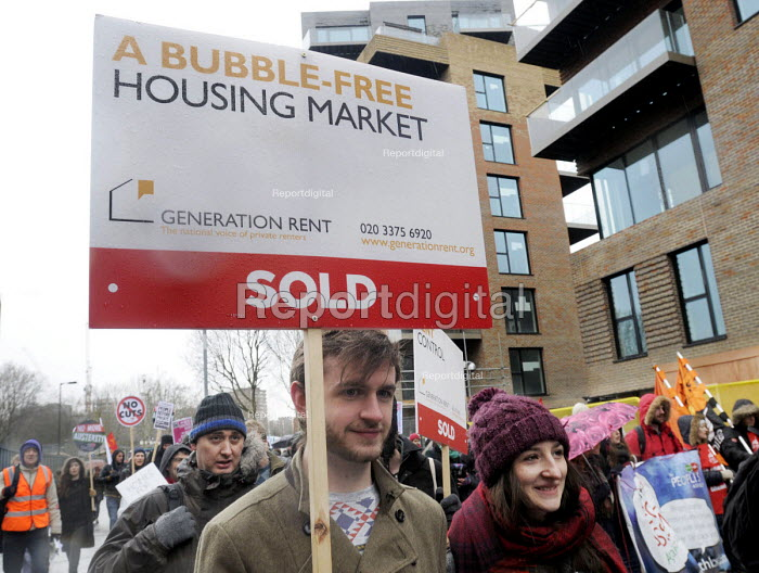 March For Homes. Demonstration for affordable housing, rent controls and building of new social housing in the UK. The protest passes by new build properties in south London. - Stefano Cagnoni - 2015-01-31