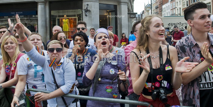 Crowd cheers as Women from London Fire Brigade on Pride in London Parade, 2015 passes, London, 2015. - Stefano Cagnoni - 2015-06-27