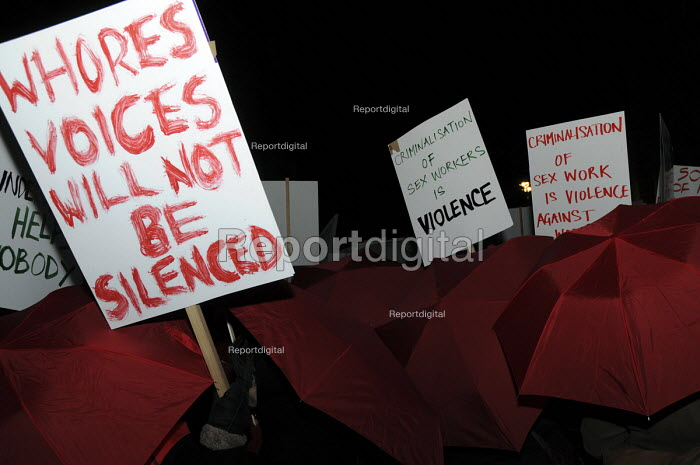 Women with umbrellas and banners and placards at Reclaim the Night march, Whores Voices will not be Silenced against the criminalisation of sex workers. - Janina Struk - 2008-11-22