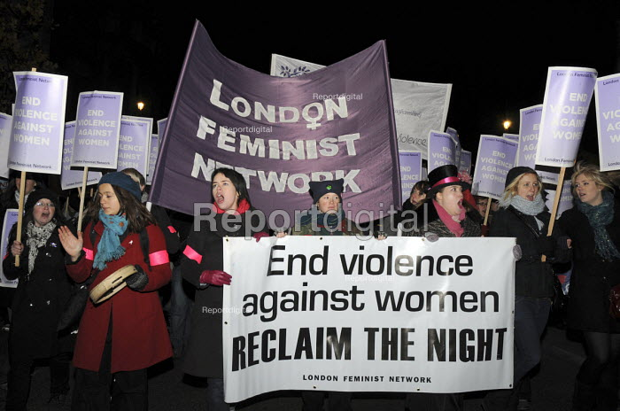 Women sing and march with placards in central London on Reclaim the Night march and a banner End Violence Against Women. - Janina Struk - 2008-11-22