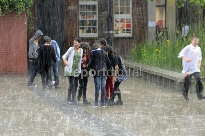 Soaked pupils in the school playground enjoying a hail storm, Hampstead School. - Janina Struk - 2009-06-15