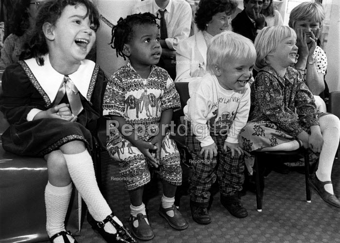 Children laughing at a performance given by a clown at a party. - Janina Struk - 1996-12-20