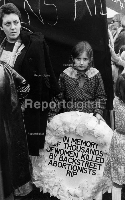 A young girl with an inscribed wreath in memory of those thousands women killed by a backstreet abortion at a Women's Right to Choose demonstration. - Janina Struk - 1980-09-12