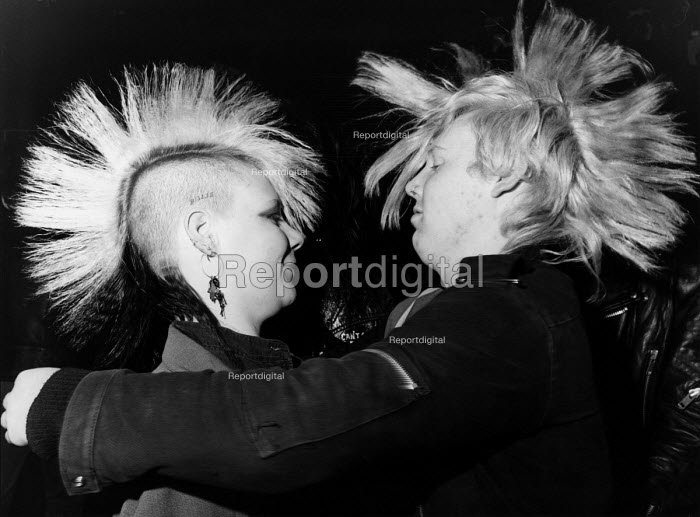 A young punk couple dancing at a gig at a club in Sunderland with mohican haircuts - Janina Struk - 1987-04-02