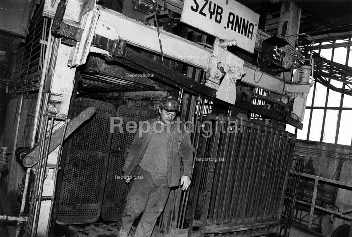 Polish miner emerges from the metal cage lift after a shift underground in a coal mine, Silesia, Poland - Janina Struk - 1996-09-21