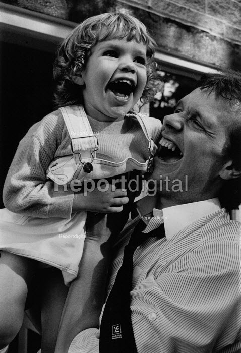 A happy father and daugher enjoying a laugh together. - Janina Struk - 1992-05-03