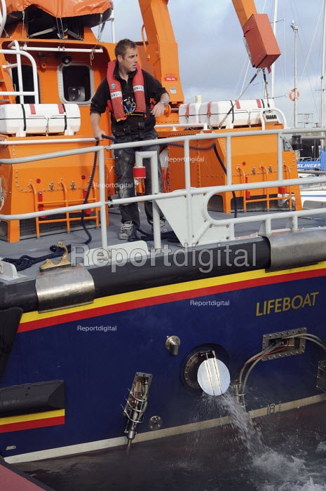 A crew member prepares the LNLI Lifeboat to leave Newlyn Harbour. - Janina Struk - 2009-09-28