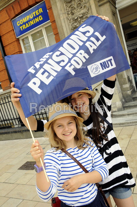 Two girls with a NUT banner at a rally in Windrush Square, Brixton, on a day of public sector strikes to defend the cuts to public service pensions. - Janina Struk - 2011-06-30